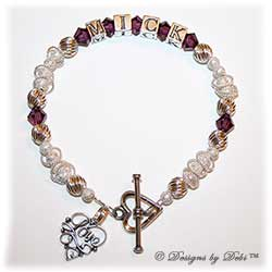 Designs by Debi Handmade Jewelry Keepsake Bracelet in the Isabella Style Twist and Stardust bead combination with Amethyst (February) crystals, a Heart toggle clasp and Love Filigree charm.  Wife's Bracelet Girlfriend's Bracelet
