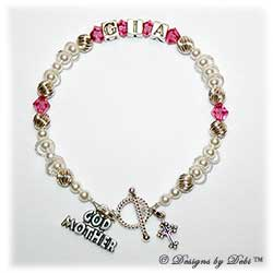 Designs by Debi Handmade Jewelry Keepsake Bracelet in the Isabella Style Twist and Pearls bead combination with Rose (October) crystals, a Bright Twisted Rope toggle clasp, Godmother charm and additional Cross charm. Godmother's Bracelet