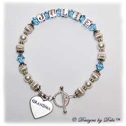 Designs by Debi Handmade Jewelry Keepsake Bracelet in the Jasmine Style Corrugated and Pearls bead combination with Aquamarine (March) crystals, a bright twisted rope toggle clasp and Grandma heart charm. Grandmother's or Nana's Bracelet