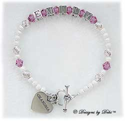 Designs by Debi Handmade Jewelry Keepsake Bracelet in the Karen Style Twist and Stardust bead combination with Rose (October) crystals, a heart toggle clasp and Grandma heart charm. Grandmother's or Nana's Bracelet