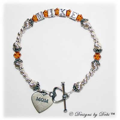 Designs byDebi Handmade Jewelry Marisol Style Bracelet in the Twist bead combination with Topaz (November) crystals, a heart toggle clasp and Mom heart charm.