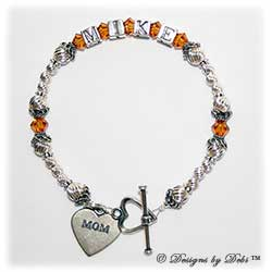Designs by Debi Handmade Jewelry Keepsake Bracelet in the Marisol Style Twist bead combination with Topaz November) crystals, a heart toggle clasp and Mom heart charm. Mother's Bracelet