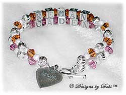Designs by Debi Handmade Jewelry 2 strand Keepsake Bracelet in the Melania Style Twist and Stardust bead combination with Topaz (November) and Rose (October) crystals, a Heart toggle clasp and Mom heart charm. Mother's Bracelet