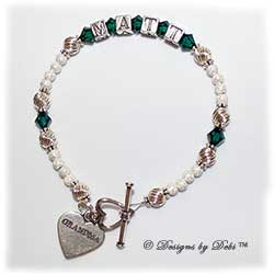 Designs by Debi Handmade Jewelry Keepsake Bracelet in the Zoe Style Twist and Stardust with Antiqued bead combination, Emerald (May) crystals, a heart toggle clasp and Grandma heart charm. Grandmother's or Nana's Bracelet