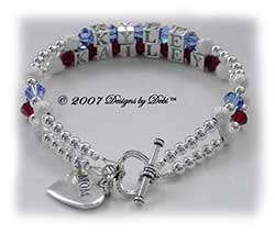 Designs by Debi Handmade Jewelry Personalized Keepsake Bracelet 2 strand Keepsake Bracelet in the Karen Style Stardust and Seamless Round bead combination with Sapphire (September) and Siam (July) crystals, a heart toggle clasp and Mom heart charm. Mother's Bracelet