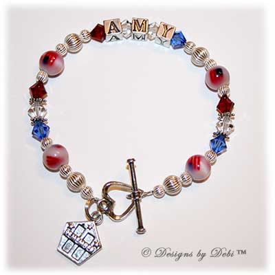 Designs by Debi Handmade Jewelry Personalized Remember 9/11 Bracelet Amy with red, white and blue Swarovski crystals, sterling silver and fiber optic flag beads, a heart toggle clasp and Remember charm with the Twin Towers and stars.